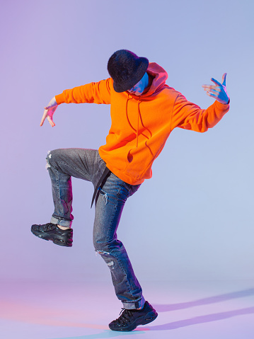 Boy dancing contemporary dance in studio. Breakdancing