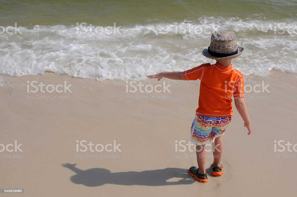 Boy Dancing in Surf stock photo