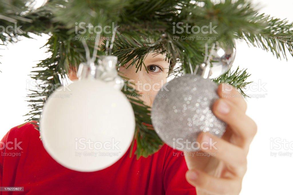 boy decorating a christmas tree royalty-free stock photo