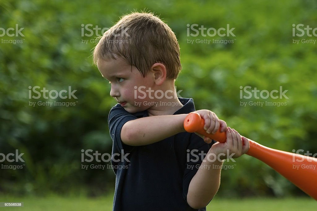 Boy Determined to Hit Ball royalty-free stock photo