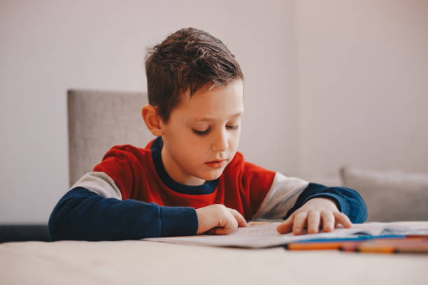 Boy doing his school work or homework Boy doing his school work or homework learning difficulty stock pictures, royalty-free photos & images