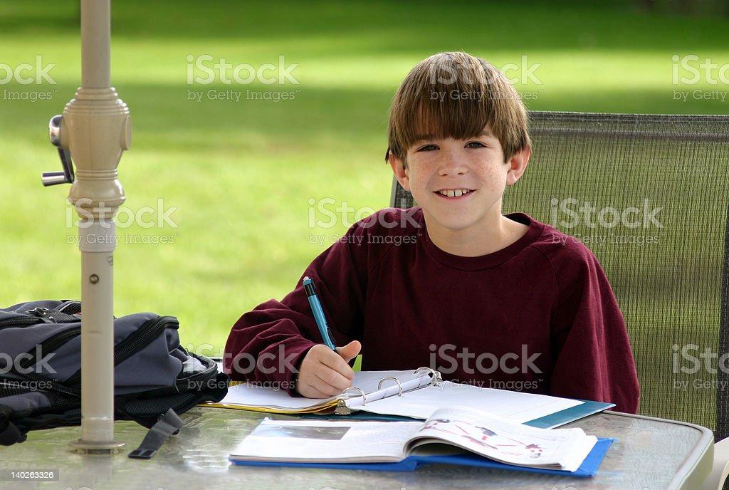 Boy Doing Homework royalty-free stock photo