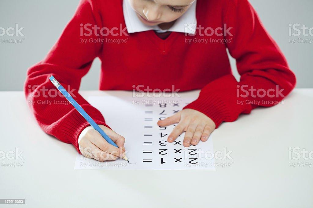 Boy Doing Multiplication Homework stock photo