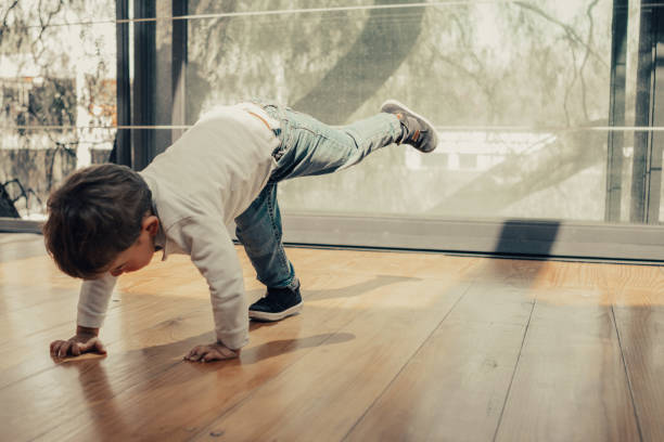 Boy doing yoga stock photo