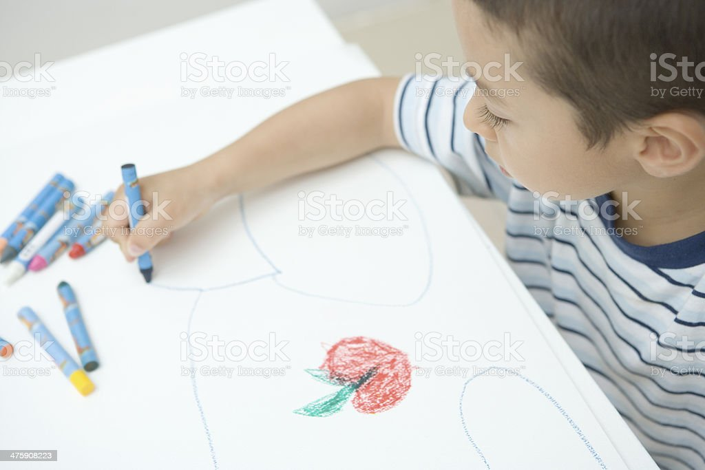 Boy drawing a picture stock photo