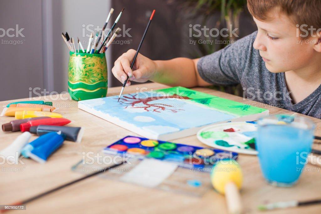 Boy Drawing at Home