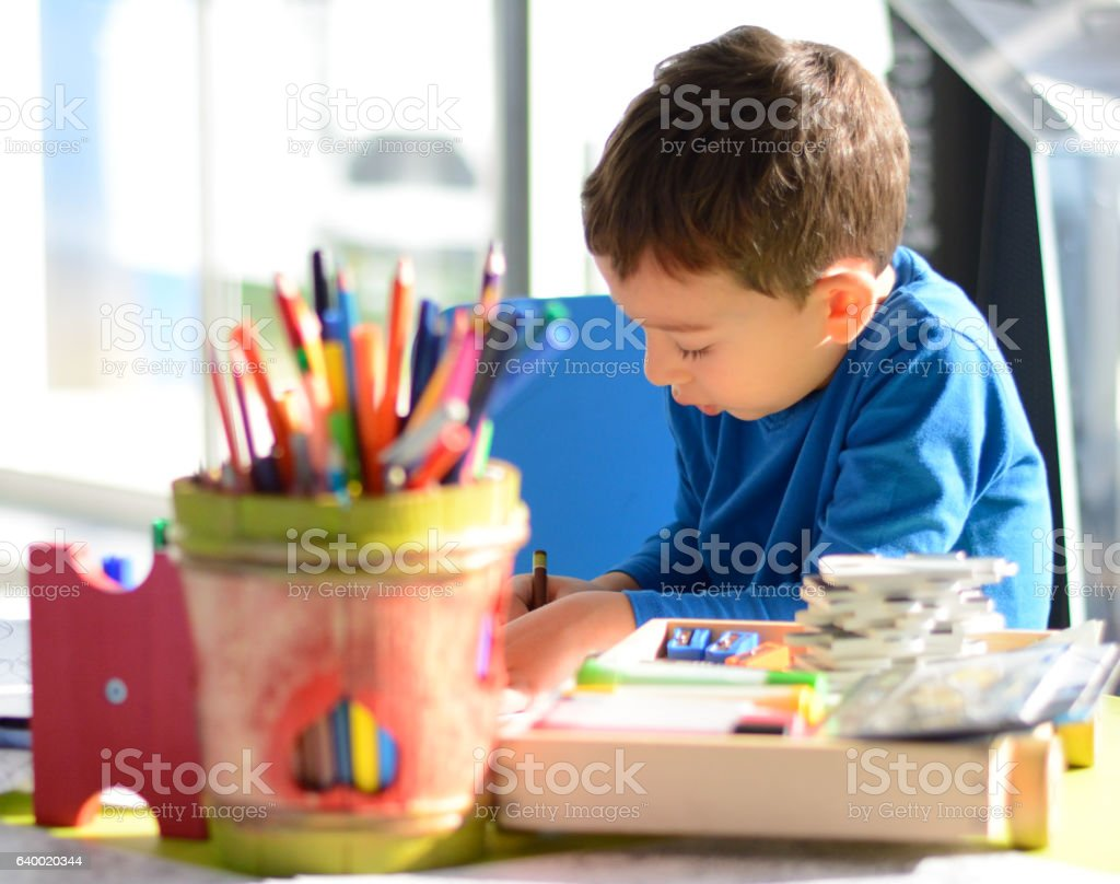 Boy Drawing in Playroom stock photo