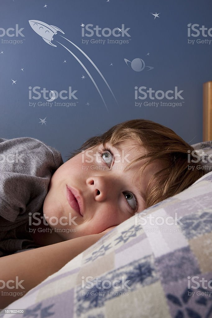 Boy dreaming of rockets and space stock photo