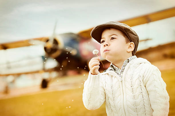 Boy dreams of flying stock photo