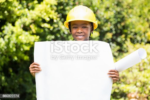 istock Boy dressed as an architect holding a plan 660322274