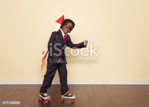 472091427 istock photo Boy Dressed in Business Suit and Rocket in Studio 472103009
