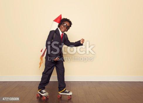 472091427istockphoto Boy Dressed in Business Suit and Rocket in Studio 472103009