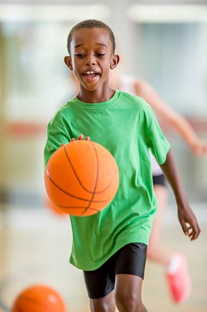 Boy Dribbling a Basketball stock photo