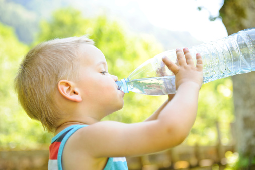 istock Boy drinking water from a clear bottle 185283395