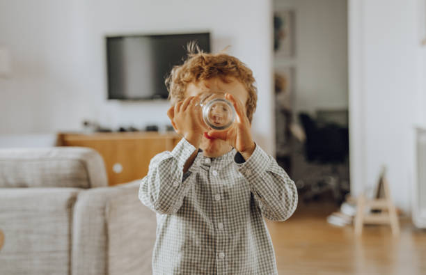 Boy drinking water stock photo