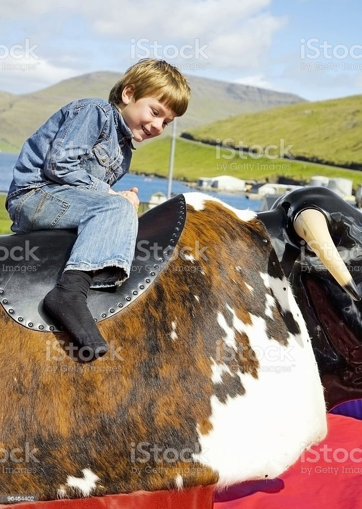 Boy drive on an attraction royalty-free stock photo