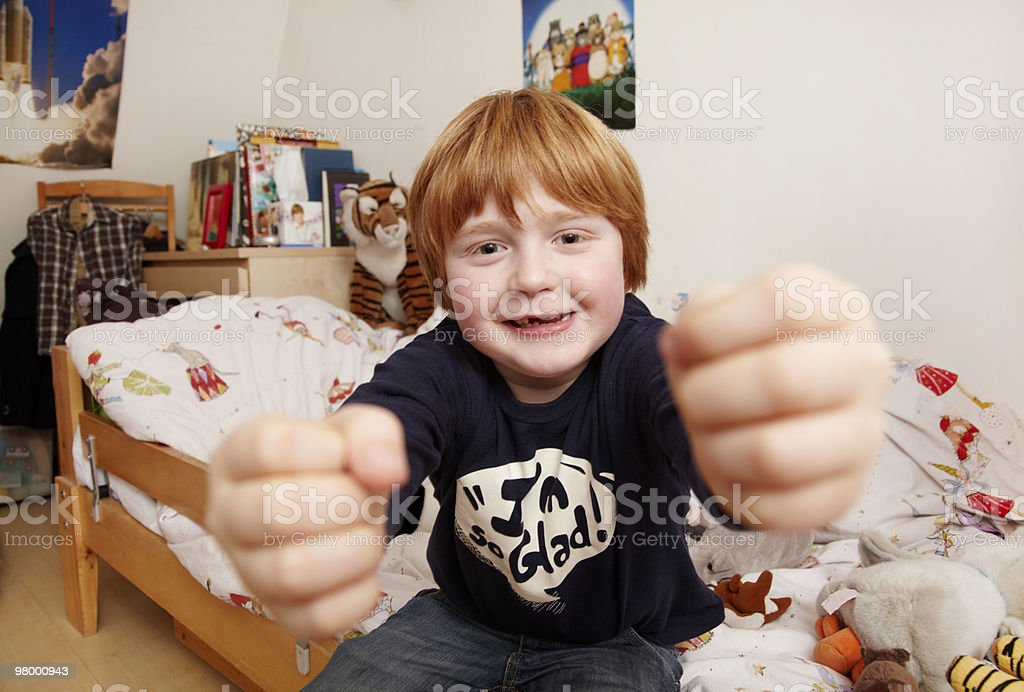 boy driving an imaginary car in his room royalty-free stock photo