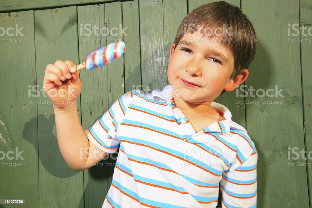 Boy Eat Same Color Popsicle royalty-free stock photo