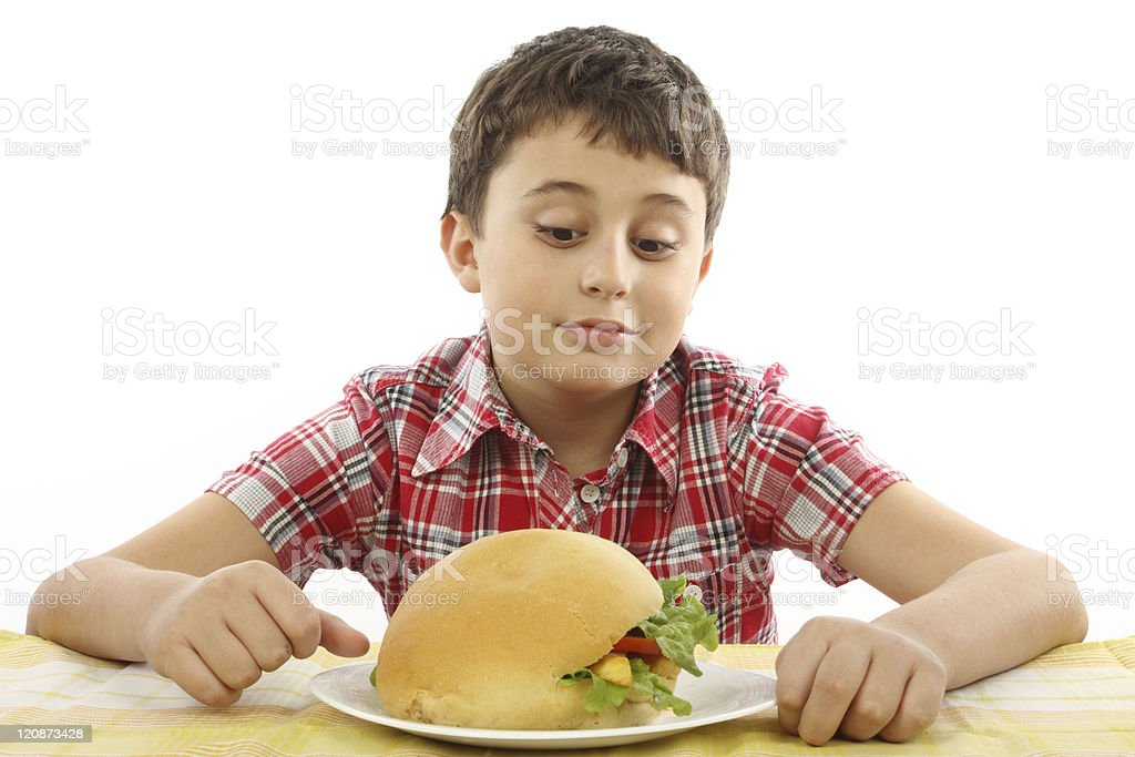 boy eating a big hamburger stock photo