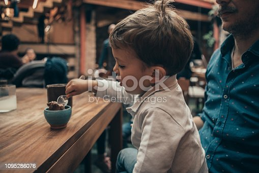Boy eating at a Mexican Restaurant
