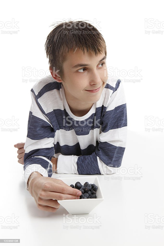 Boy eating blueberries royalty-free stock photo