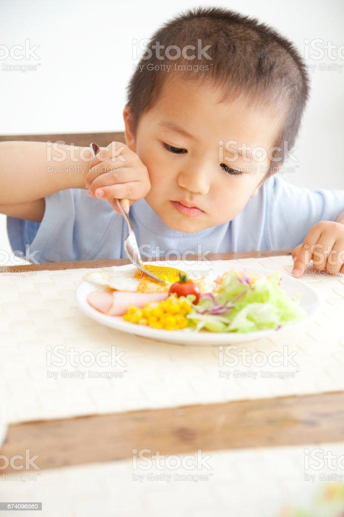 Boy eating breakfast royalty-free stock photo