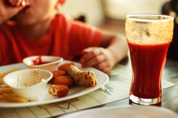 Royalty Free Boy Eating Chicken Nugget Pictures Images And Stock