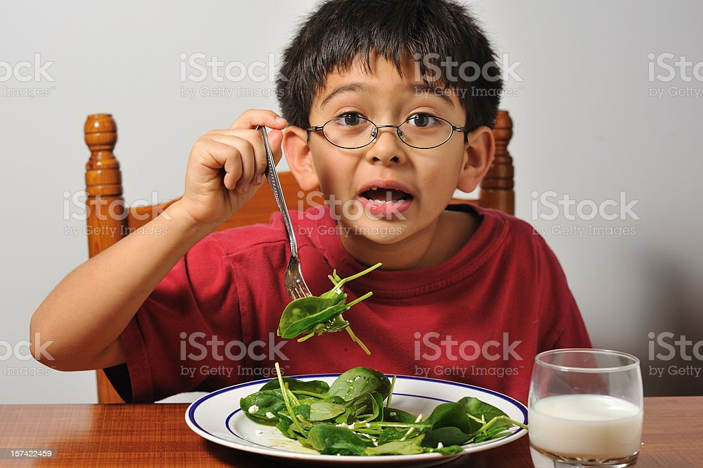 Boy eating veggies with milk royalty-free stock photo