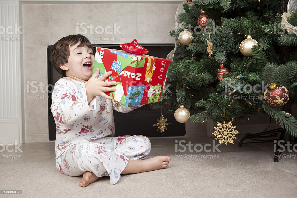 Boy ecstatic about Christmas present royalty-free stock photo