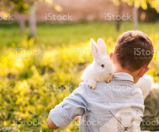 Boy embracing his rabbit in the park picture id613101362?b=1&k=6&m=613101362&s=612x612&h=7svcwe9qb6 vruvovuhgliqzmmk9mzmqibnsyg13ude=