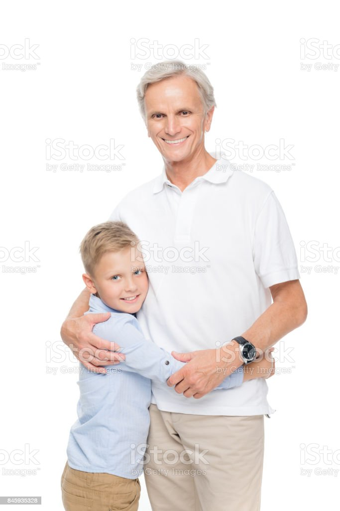 boy embracing with grandfather stock photo