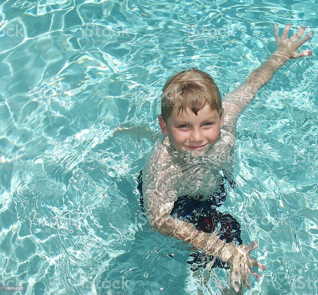 boy exercising in pool royalty-free stock photo