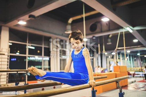 Cute boy exercising gymnastic.