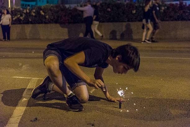 Boy exploding firecrackers stock photo