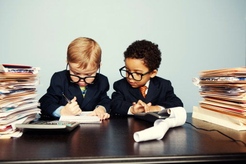 Boy Financial Advisors Add Numbers on Calculator
