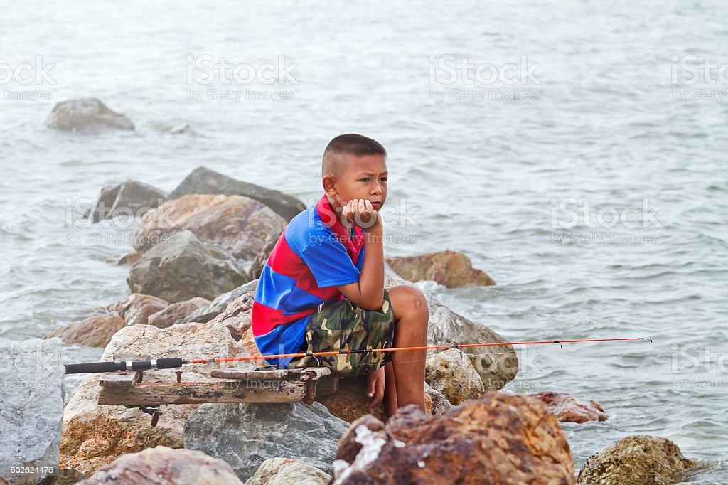boy fishing at thai sea royalty-free stock photo