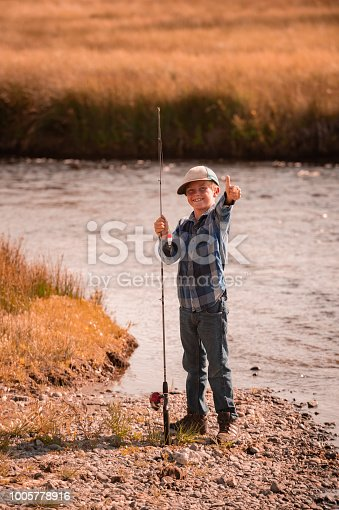 Boy Fishing In The Mountains