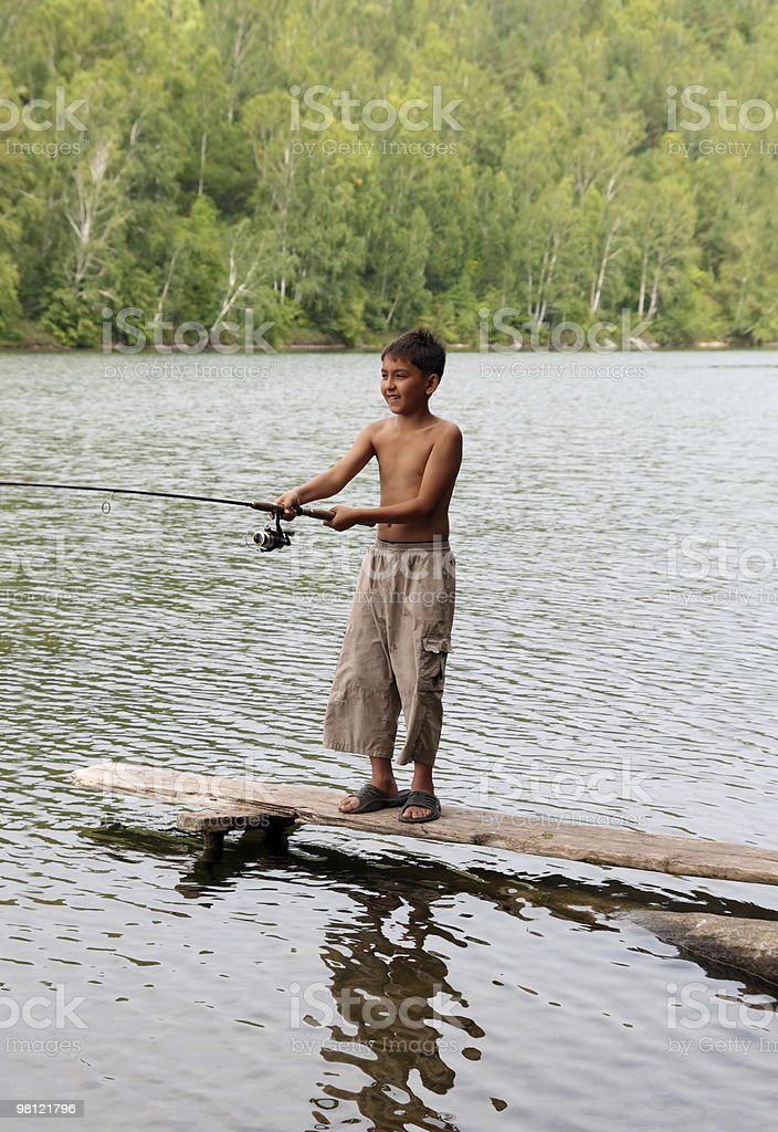 boy fishing with spinning royalty-free stock photo