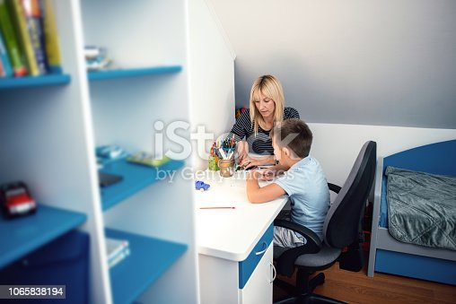 istock Boy focusing on homework 1065838194