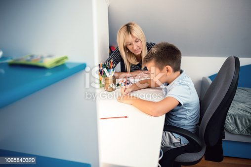 istock Boy focusing on homework 1065840320