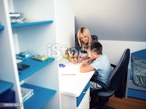 istock Boy focusing on homework 1065843012