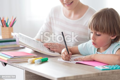1020504438istockphoto Boy focusing on homework 843565784