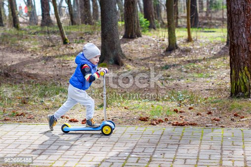 665192886 istock photo boy, four years old is riding a scooter 982666488