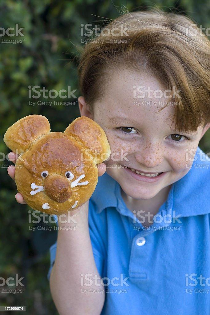 Boy Freckle Face Smiling, Child Eating Breakfast Bread Brioche Bun royalty-free stock photo
