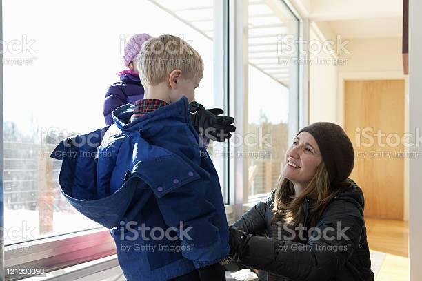 Boy getting dressed in winter clothing mother helping picture id121330393?b=1&k=6&m=121330393&s=612x612&h=c6yvdwusfrvvg7evjhtdeuq9mt8arbqw juuvhvygvq=