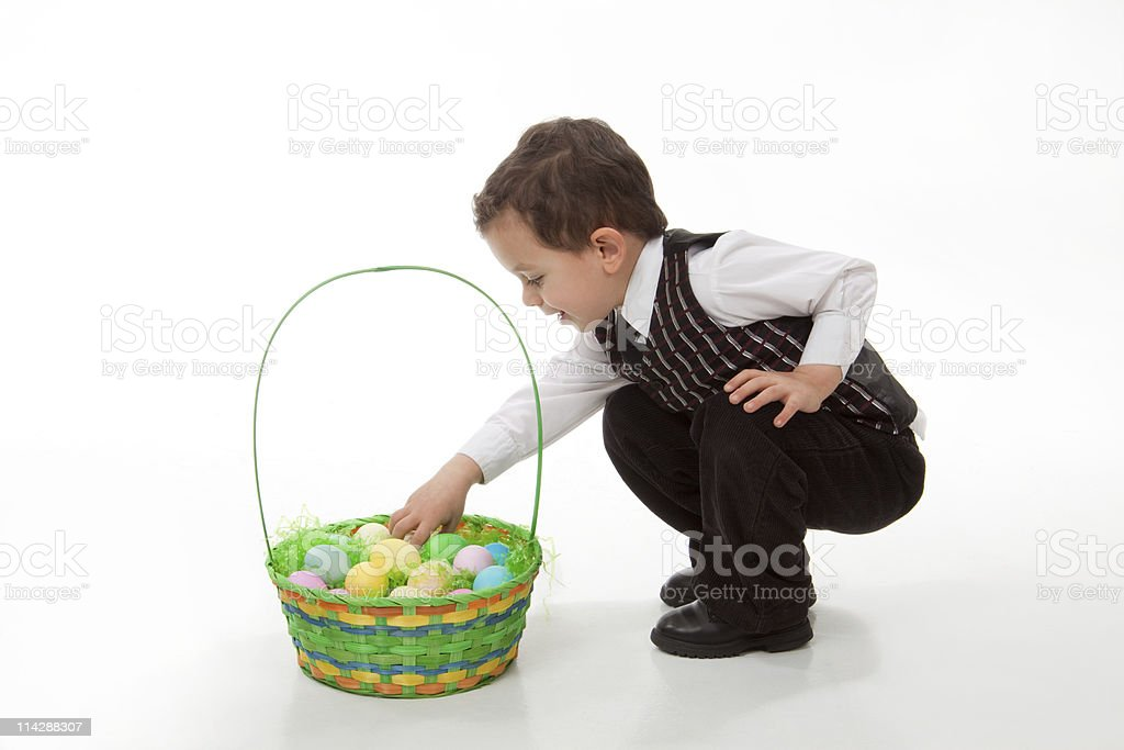 Boy Getting Egg out of Easter Basket royalty-free stock photo
