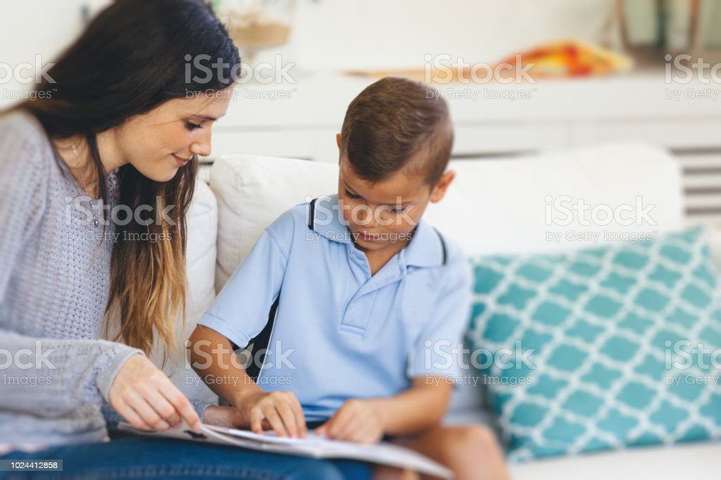 boy getting help with his homework stock photo