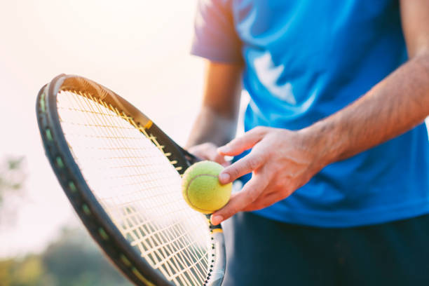 boy getting ready for a serve in tennis. - tennis stock pictures, royalty-free photos & images