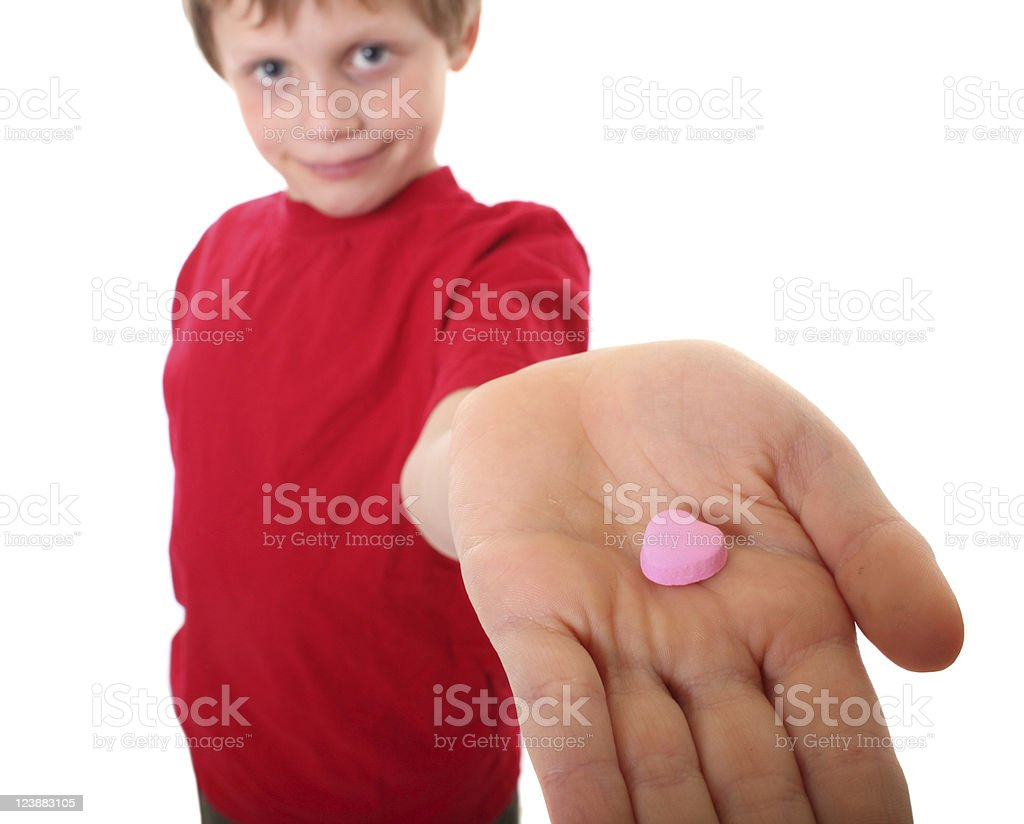 boy giving candy heart royalty-free stock photo