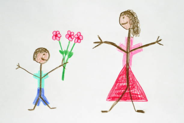 Boy Giving Flower to his Mother stock photo